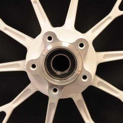 PVM white 10 spoke wheel closeup